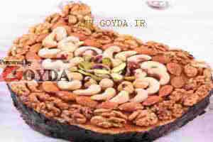 طرز تهیه کیک آجیلی با تزئین آجیل کره و عسل